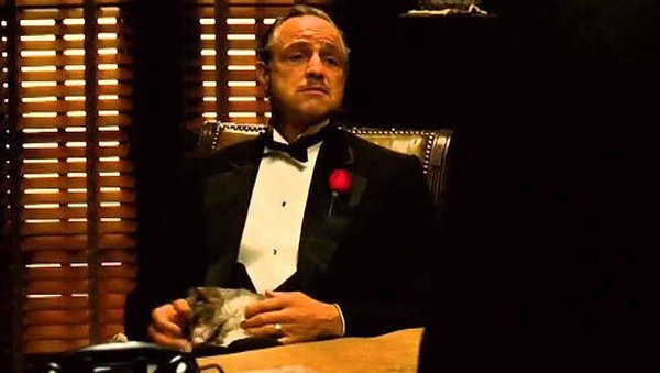 Vito Corleone (Marlon Brando) with cat in The Godfather. The cat was a stray Francis Ford Coppola found on the lot at Paramount Studios.