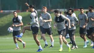 Virgil van Dijk leads a training session in Doha