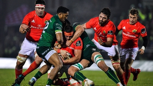 CJ Stander of Munster is tackled by Bundee Aki