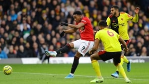 Anthony Martial of Manchester United shoots wide under pressure from Troy Deeney and Etienne Capoue
