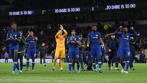 Chelsea players salute their fans after their 2-0 win at Tottenham