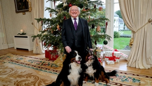 President Higgins with his dogs Bród and Síoda as he delivers his Christmas and New Year's Day message in Áras an Uachtaráin