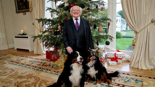 Michael D Higgins pictured with his two dogs last Christmas