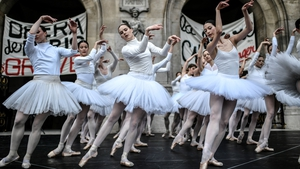 Paris Opera dancers perform in front of the Palais Garnier against the French government's plan to overhaul the country's retirement system