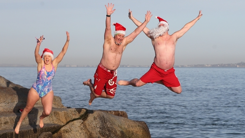 People take part in the annual Christmas Day swim at the Forty Foot in Dublin