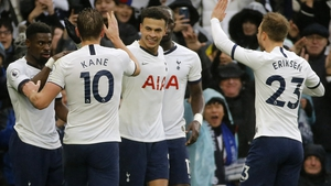 Dele Alli celebrates the winner with his Tottenham team-mates