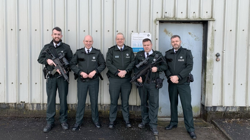 A picture         posted on his Twitter account shows PSNI Chief Constable Simon         Byrne posing with officers armed with machine guns