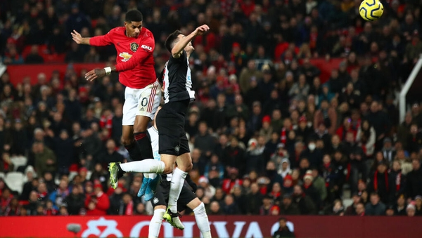 Marcus Rashford leaps highest to score Manchester United's third goal at Old Trafford