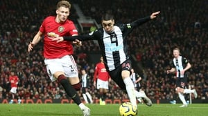 Scott McTominay attempts to tackle Newcastle's Miguel Almiron