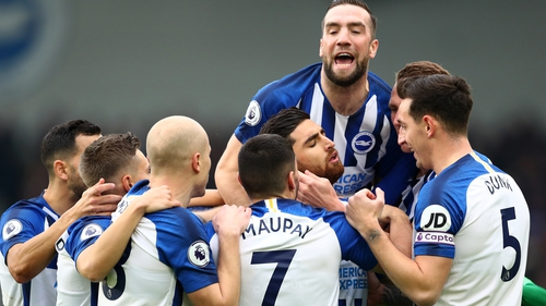 Shane Duffy (top) joins in the celebrations after Alireza Jahanbakhsh's goal