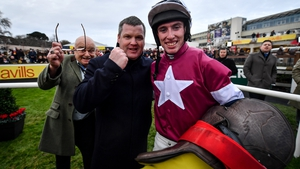 Jack Kennedy (R) celebrates with trainer Gordon Elliott (C) after riding Delta Work to win the Savills Chase