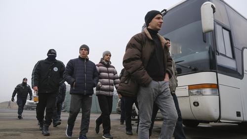 Prisoners walk before a prisoner exchange between Ukrainian and pro-Russian rebels' sides