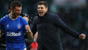 Steven Gerrard celebrates (R)