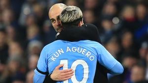 Manchester City manager Pep Guardiola (L) hugs Sergio Aguero