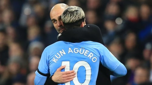 Manchester City manager Pep Guardiola (L) hugs Sergio Aguero