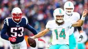 Ryan Fitzpatrick (r) set up the pass that saw Miami Dolphins defeat New England Patriots