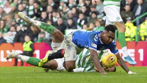 Rangers' Alfredo Morelos goes to ground after a challenge from Celtic's Christopher Jullien