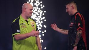 Michael van Gerwen shakes hands with Nathan Aspinall after his semi-final victory