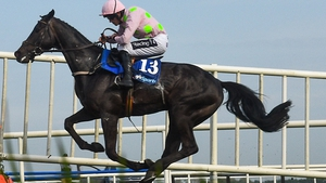Irish Grand National winner Burrows Saint reverted to hurdles and coped with the drop in trip admirably
