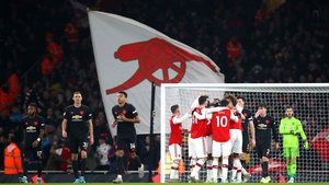 Arsenal players celebrate Sokratis Papastathopoulos's goal at the Emirates