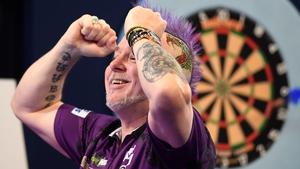 Peter Wright reacts to his win over Michael van Gerwen