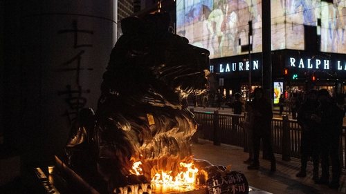 The two lions outside HSBC were set alight after being doused in a flammable liquid
