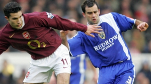 Chris Barker (R) in action for Cardiff City against Robin van Persie in an FA Cup clash back in 2006