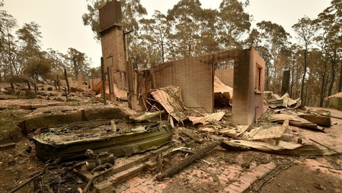 The remains of a house destroyed by a bushfire is seen just outside Batemans Bay in New South Wales today