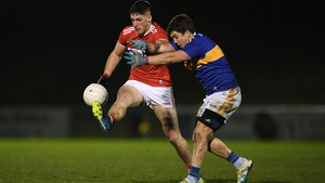 Colm O' Callaghan of Cork is tackled by Robbie Kiely of Tipperary