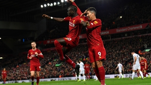 Liverpool's Sadio Mane (L) celebrates his goal with Roberto Firmino