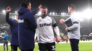 Wayne Rooney gets a pat on the head for a job well done