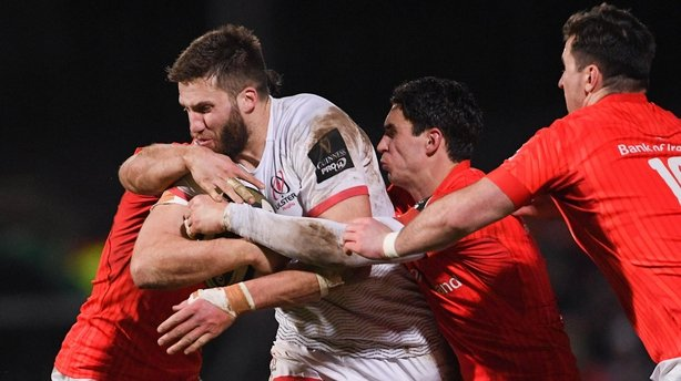 Ulster's Stuart McCloskey is tackled by Munster's Sammy Arnold (left) and Joey Carbery