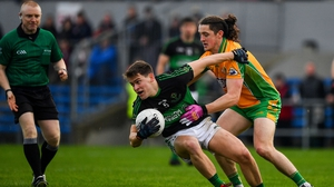 Kevin O'Donovan of Nemo Rangers is tackled by Kieran Molloy of Corofin
