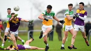 Jason Dempsey of Offaly in action against Tom Byrne of Wexford