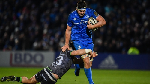 Max Deegan breaks through the tackle of Tiernan O'Halloran