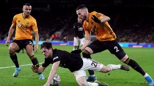 Daniel James and Matt Doherty battle for possession