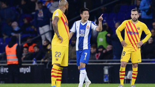 Wu Lei celebrates his equaliser against Barcelona