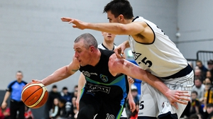 Kieran Donaghy of Garvey's Warriors Tralee in action against Marko Tomic of DBS Eanna