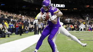 Kyle Rudolph #82 of the Minnesota Vikings makes the game-winning touchdown reception against P.J. Williams #26 of the New Orleans Saints