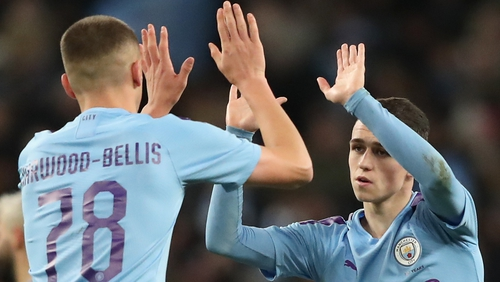Taylor Harwood-Bellis (L) and Phil Foden helped Manchester City past Port Vale in the third round