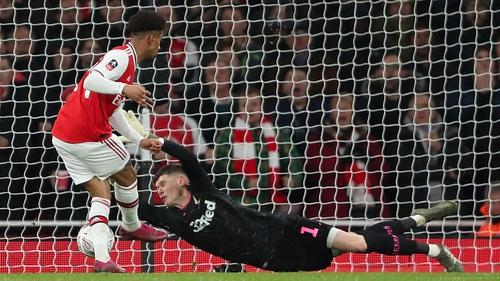 Reiss Nelson slides home the winning goal for Arsenal