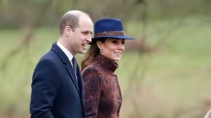 Kate chose muted browns and a pop of blue for her first appearance of the new year. Photo: Getty