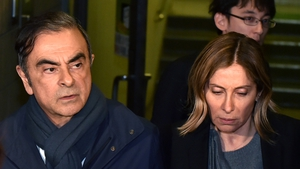 Former Nissan Chairman Carlos Ghosn's bail conditions included restrictions on contact with his wife Carole