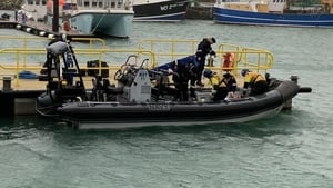 Navy divers loading their gear before heading out to the search site off Hook Head