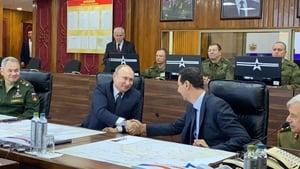 Vladimir Putin and Bashar al-Assad shaking hands in Damascus