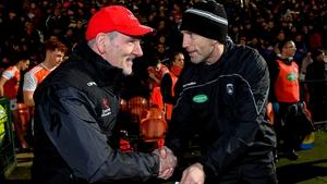 Tyrone supremo Mickey Harte is congratulated by Armagh boss Kieran McGeeney