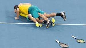 Alex de Minaur was overcome by joy - and Nick Kyrgios - after the pair's win over Jamie Murray and Joe Salisbury
