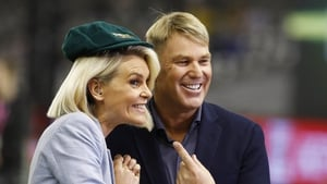 Fox Sports commentator Sarah Jones and Shane Warne, with his baggy green cap which has been sold for more than $1 million