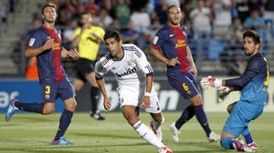 Juanfran Moreno of Real Madrid Castilla celebrates after scoring his team's first goal during the La Liga Adelante match between Real Madrid Castilla and Barcelona B at Estadio Alfredo Di Stefano in 2012