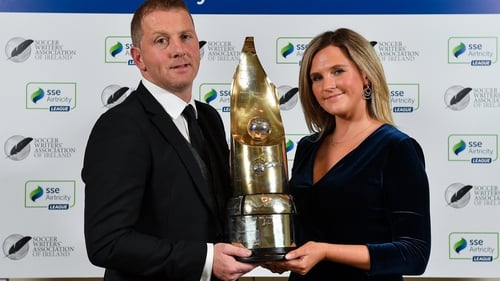 Vinny Perth accepts his award from SSE Airtricity marketing manager Leanne Sheill